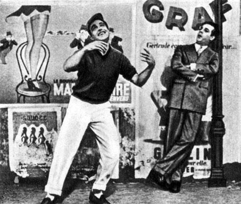 'Американец в Париже'. Реж В. Миннелли. (Слева - актёр Дж. Келли.) 1951